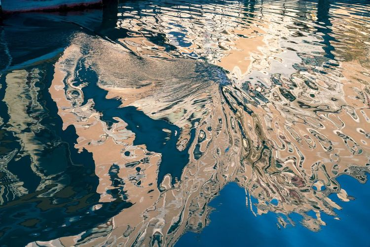 High angle view of reflection water in canal