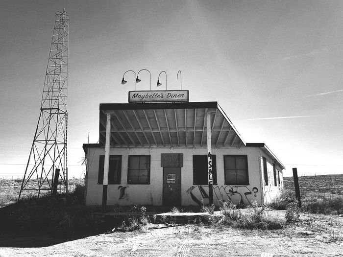 """Maybelle's Diner"" A now abandoned building, Maybelle's Diner once served travelers along Route 66 on the way to Los Lunas, New Mexico. Restaurants Black And White Photography Black And White Blackandwhite Route 66 Historical Building Abandoned Buildings Abandoned Places Abandoned Built Structure Architecture Building Exterior Sky Building Day"