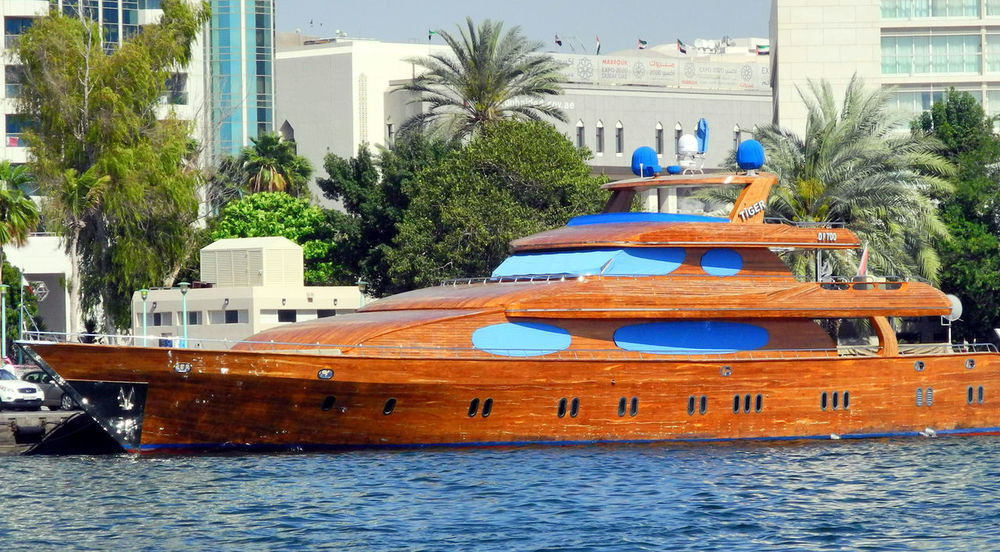 Dubai Creek - Clinker built wooden yacht Architecture Building Exterior Built Structure Day Dubai Dubai Creek Nautical Vessel No People Outdoors Palm Tree Tree Water Waterfront Yacht Yachting
