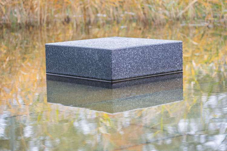 Autumn in the city - Marble block reflecting in water Autumn Autumn Collection Block Shape City Close-up Day Marble Modern Nature No People Outdoors Reed - Grass Family Reflection Simplicity Square Shape Stone - Object Stone Material Symmetry Water Waterfront The City Light Minimalist Architecture The Architect - 2017 EyeEm Awards