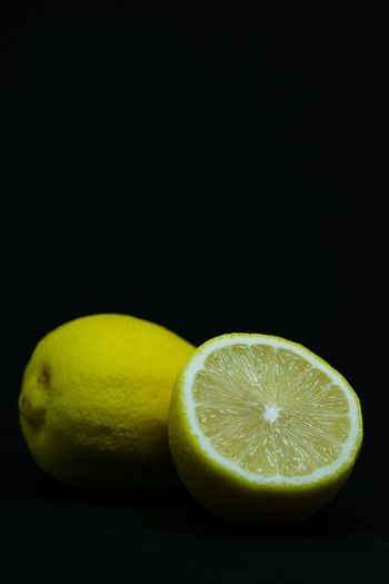 Close-up of lemon slice against black background