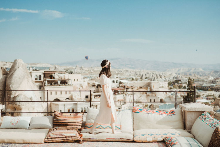 One Person Women Young Adult Adult Full Length Day Young Women Sky Clothing Nature Sitting Lifestyles Wedding Architecture Fashion Newlywed Bride Building Exterior Leisure Activity Hairstyle Outdoors Contemplation