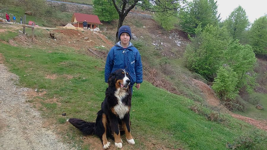 My son with a big dog Outdoors Standing Childhood Nature Warm Clothing Animal Themes Tree EyeEmNewHere Green Background Rural Scene Big Dog Posing For The Camera Big Dog Outdoors Boy