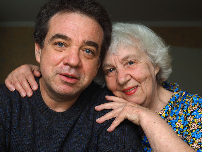Close-up portrait of mother with son at home
