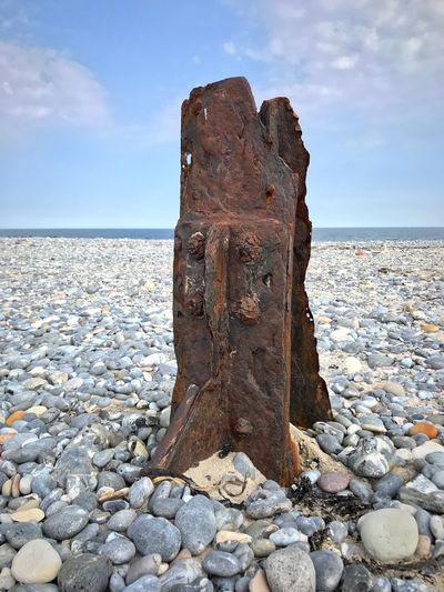 Northsea Northern Germany One Object Clouds And Sky Sand Structure Structured Material Historical Artifact Iseefaces Daylight Fragment Rusty Metal Rusty Pebbles Sea Sky Water Beach Horizon Over Water Land Horizon Nature Solid Tranquility Scenics - Nature Day Outdoors No People