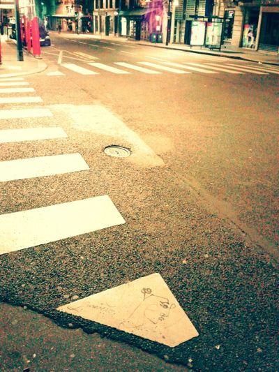 Streetphotography Streetart Nightphotography ParisianLifestyle Paris, France  Macadam Zebra Crossing Perspective Low Angle View Here Belongs To Me Up Close Street Photography The Street Photographer - 2016 EyeEm Awards Colour Of Life The City Light