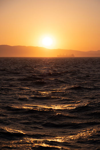 Beauty In Nature Horizon Nature No People Orange Color Scenics - Nature Sea Ship Sky Sun Sunlight Sunset Water