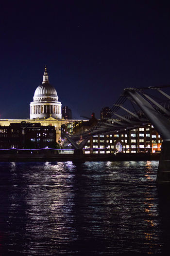 Night view of St. Paul's Cathedral , the millenium bridge and river Thames. Bridges London WallpaperForMobile Architecture Bridge Bridge - Man Made Structure Building Exterior Built Structure City Connection Dome Government Illuminated Nature Night No People Outdoors Reflection River Sky Tourism Travel Travel Destinations Water Waterfront