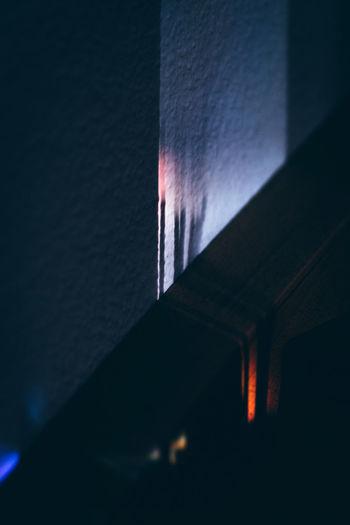 Close-up of illuminated lamp at night