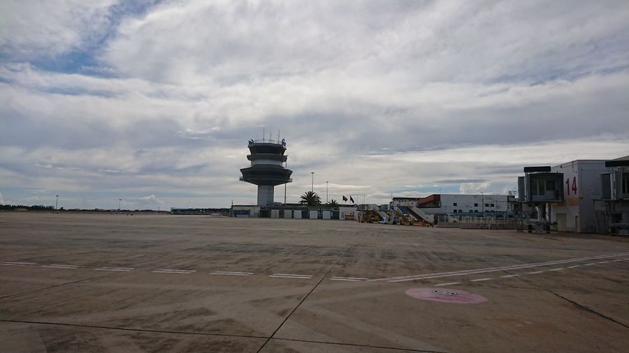 View of airport by road against sky