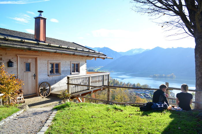 Taking a break. Amazing View Architecture Blue Sky Break Time Cliff Composition Couple Fence Germany Grass House Hütte Lake Lakeshore Landscape Outdoors Pause Perspective Schliersee Taking A Break Tourism Tree Wandering Wood Wooden House