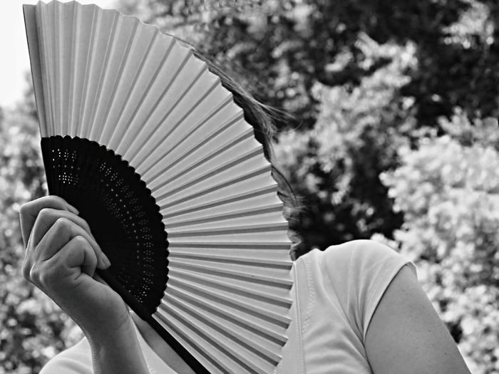 Woman Hiding Face By Hand Fan