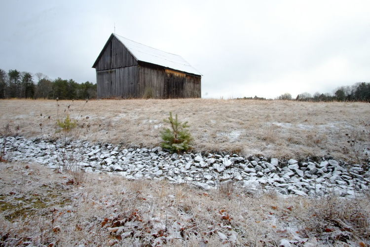 first snow Abandoned Architecture Bad Condition Building Exterior Built Structure Damaged Day Deterioration Field Grass House No People Obsolete Old Outdoors Religion Ruined Stone Stone Wall