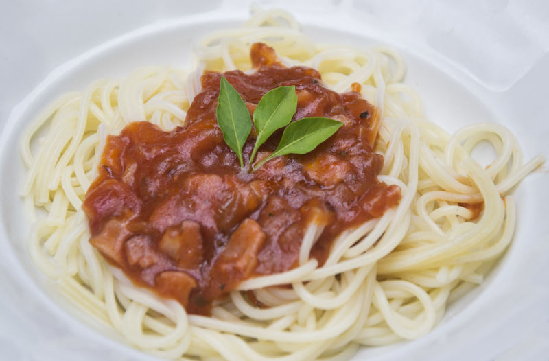 Close-up of spaghetti served with sauce in plate