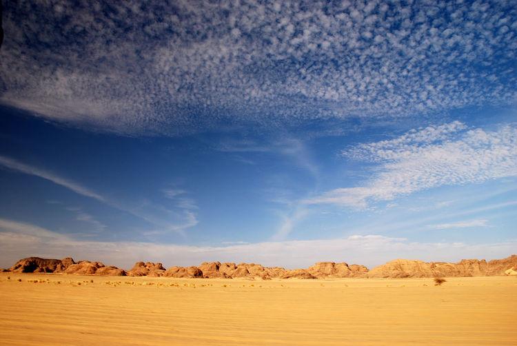 Tranquil View Of Barren Landscape Against Sky
