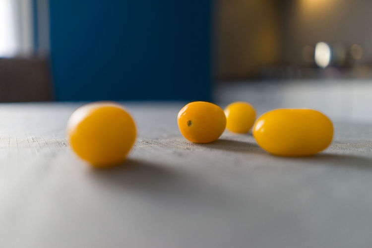 Close-up of yellow and balls on table