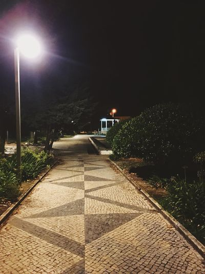 Night Illuminated Street Light Street The Way Forward Lighting Equipment Direction No People Nature Diminishing Perspective Sky Footpath Architecture Plant Outdoors City Empty Building Exterior vanishing point Road