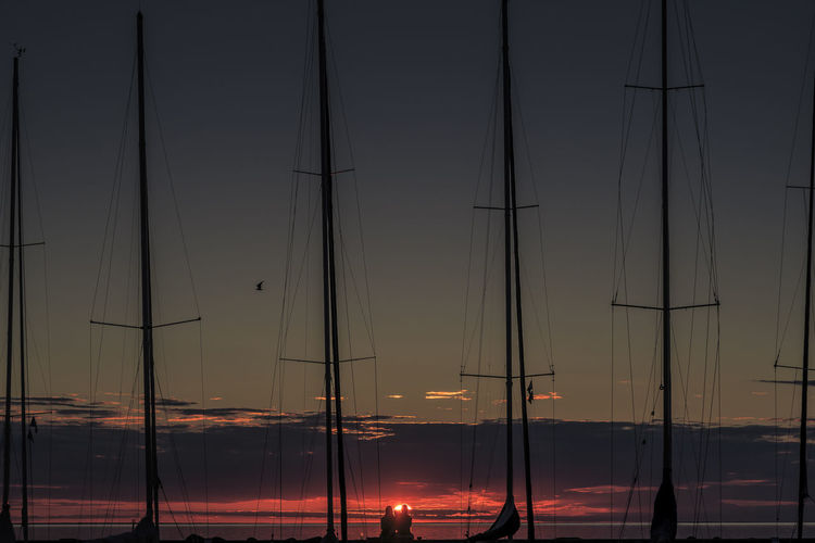 Harbour Sky And Clouds Sweden Alternative Energy Byxelkrok Fuel And Power Generation Industrial Windmill Mast Masts Nature Night Outdoors Real People Sailboat Sailboats Sky Sunset