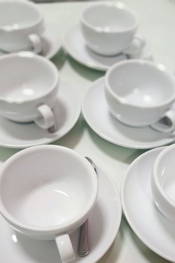 High angle view of empty coffee cups on table