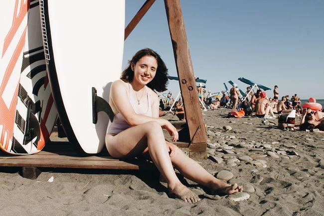 Full Length Sitting Beach Sand Smiling Portrait Sky