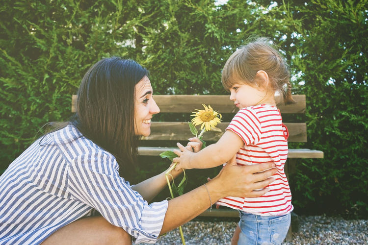 Two People Bonding Plant Togetherness Childhood Women Family Real People Females Casual Clothing Child Emotion Love Lifestyles Positive Emotion Mother Happiness Hair Outdoors Daughter Gift Mother Mother's Day Love Happiness
