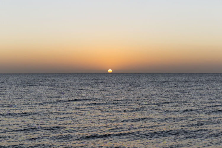 Astronomy Beauty In Nature Day Dramatic Sky Horizon Horizon Over Water Idyllic Landscape Moon Nature No People Orange Color Outdoors Scenics Sea Sky Sun Sunset Tranquil Scene Tranquility Travel Destinations Vacations Water Waterfront
