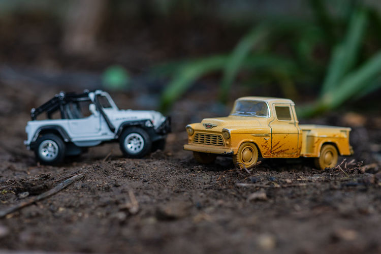 Toy Cars Toy Mode Of Transportation Car Transportation Toy Car Motor Vehicle Selective Focus Day No People Nature Land Vehicle Land Dirt Surface Level Field Small Close-up Outdoors Mud