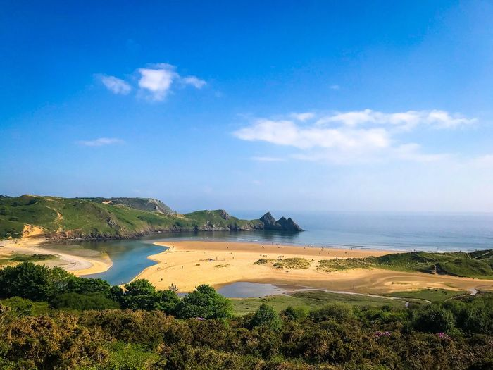 Beautiful Three Cliffs Bay in Wales Sea Ocean Water Sky Cloud - Sky Sea Nature Scenics - Nature Beauty In Nature Beach Tranquil Scene Tranquility Day No People Outdoors Land