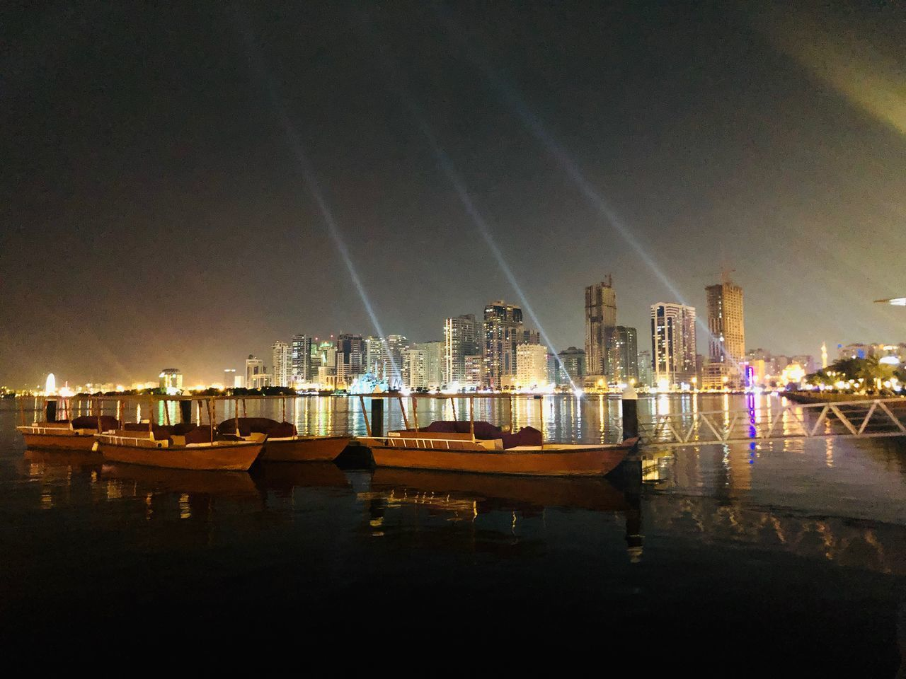 water, architecture, building exterior, built structure, illuminated, sky, night, city, no people, nautical vessel, reflection, nature, transportation, building, moored, sea, mode of transportation, outdoors, cityscape, light, marina, skyscraper, bay