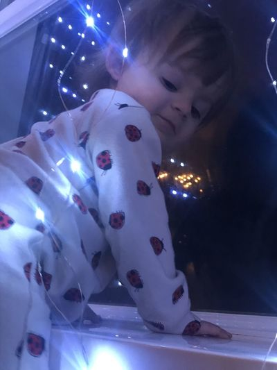 Close-up portrait of boy with illuminated lights