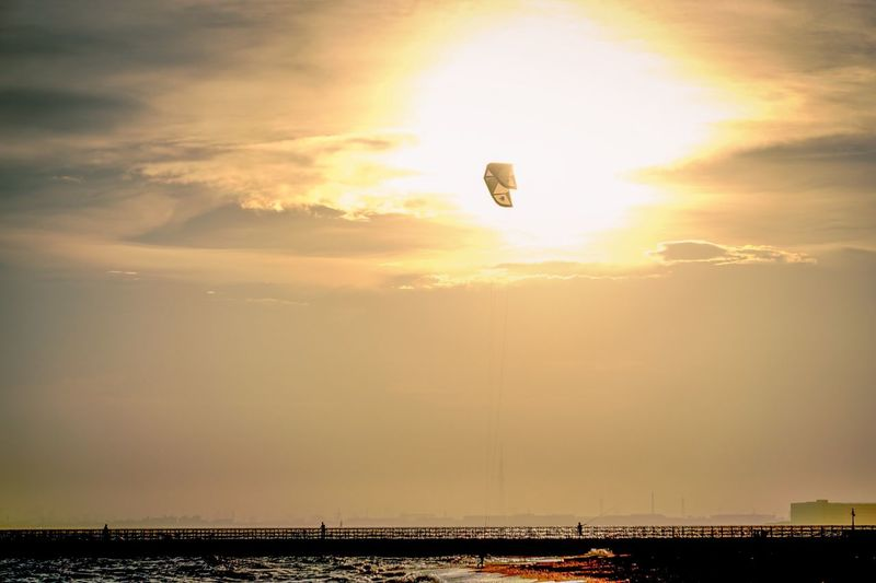 Sky Mid-air Sunset Flying Hot Air Balloon Adventure Outdoors Transportation Parachute Silhouette Nature Cloud - Sky Leisure Activity Scenics Beauty In Nature Architecture Extreme Sports No People Cityscape Day