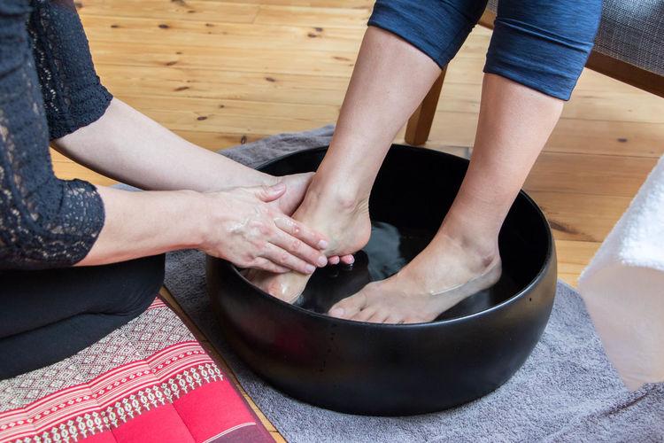 Beautician Giving Pedicure To Female Customer