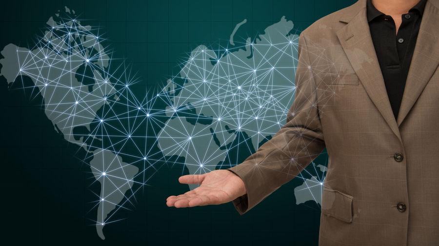 Digital composite image of man over world map