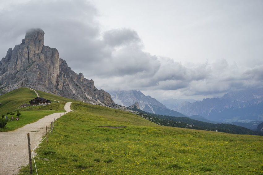 Outdoors No People Nature Italy Passo Giau Mountain Dolomites Clouds Chalet Peak Field Grass Valley Alps