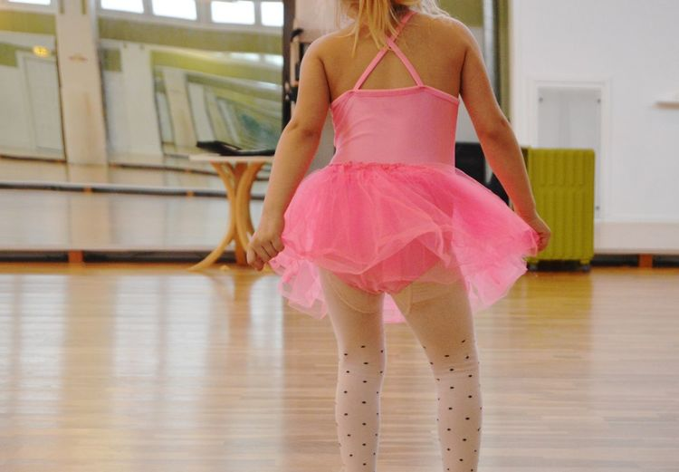 Midsection Of Girl Standing In Dance Studio