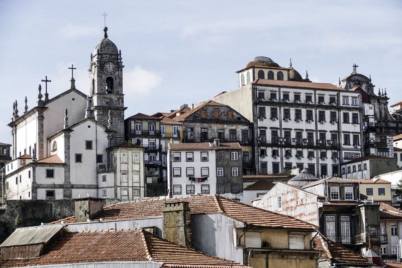Historical Buildings Against Blue Sky Architecture Old City Sky Spirituality Porto Building Day History Religion Cityscape Portugal Old Town Spire  Urban Photography Travel Photography Panoramic View No People Belief Panoramic Photography Place Of Worship Copy Space Travel Destination Building Exterior Residential District Built Structure Roof Town House Roof Tile TOWNSCAPE Spire  Outdoors