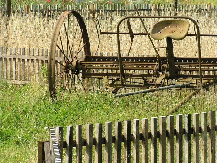 Agricultural Machinery Ancient Farm Fence Field Grass Metal No People Old Rusty Wagon Wheel Wheel Wrought Iron