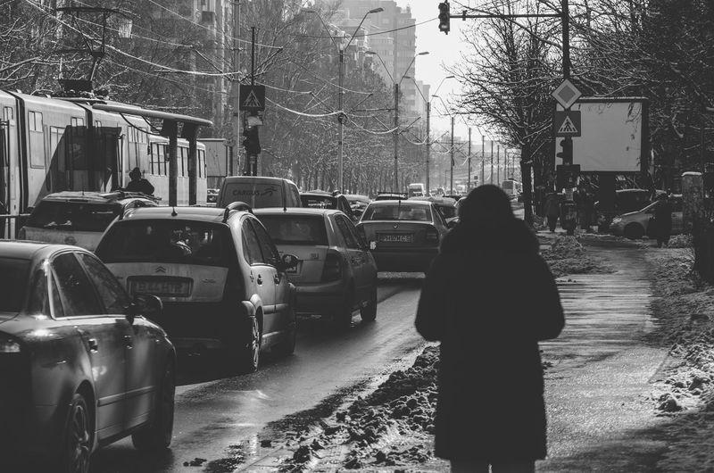 Rear view of man on street in winter
