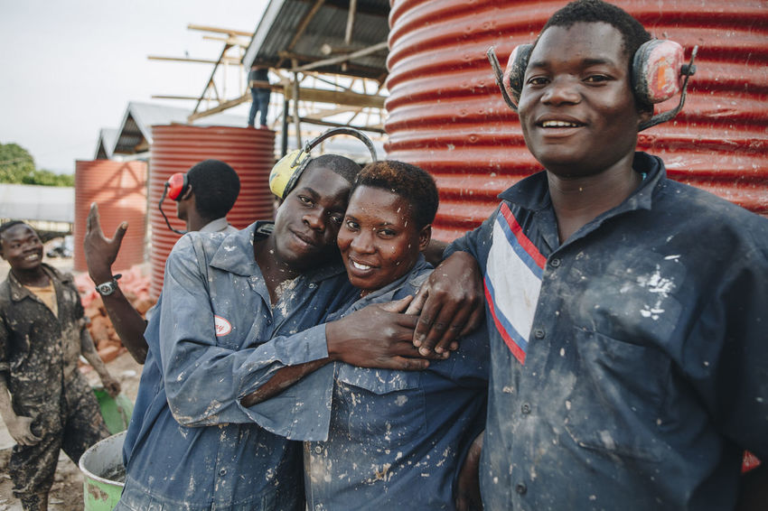 Africa African Business Dirty Ecofriendly Energy Industrial Industrial Work Industrial Workers Looking At Camera Manual Worker Men Mud People Portrait Production Protective Workwear Recycling Smiling Social Business Togetherness Women Work Workers Working