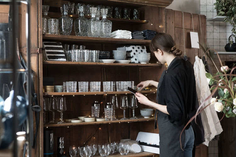 Side view of woman looking at store
