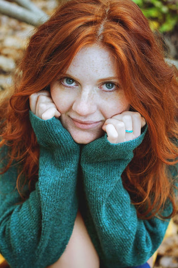 Close-up portrait of a smiling young redhead woman