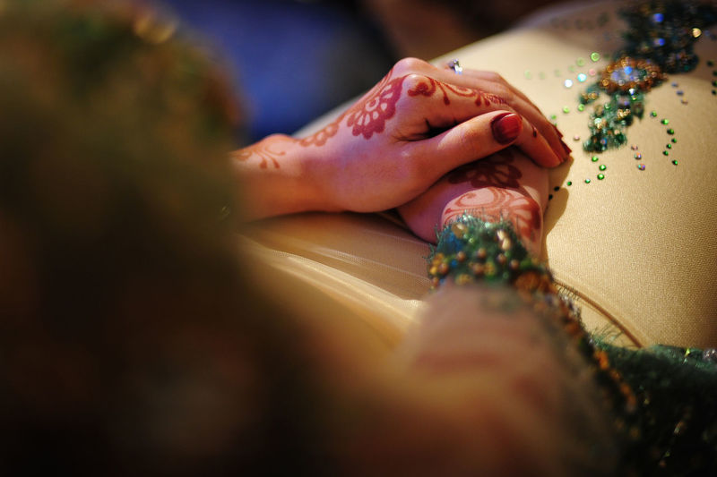 Close-up of henna tattoo on bride hands