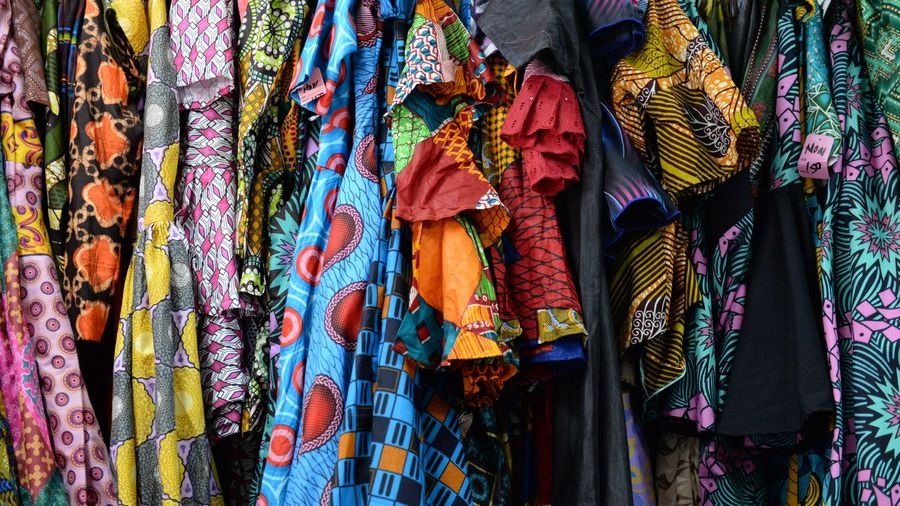 Nigerian dress shop Nigerian Dress Shop Multi Colored Hanging Textile Retail  Variation Choice Backgrounds Full Frame Market Fabric