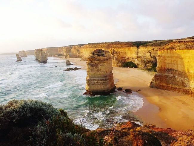 The golden sun makes everything richer Outdoors Nature Travel Destinations Landscape Tweleveapostles Greatoceanroad Port Campbell National Park Water Ocean Limestone Islands