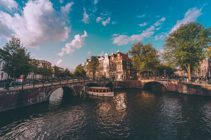 Amsterdam canals Bridge River Cloud - Sky Built Structure Architecture Water Sky City Travel Destinations EyeEm Best Shots Cityscape Amsterdam Holland Netherlands EyeEm Selects Travel Photography Day Waterfront Sunset Traveling EyeEm EyeEm Best Edits Blue Street Canal