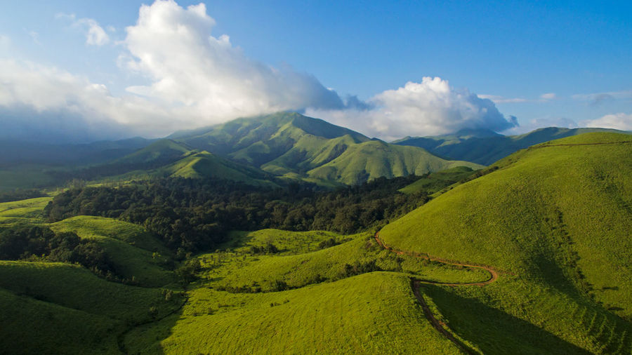 A birds eye view of the lovely mountain ranges in the Western Ghats. Perspectives On Nature Aerial Aerial Photography Aerial View Beauty In Nature Cloud - Sky Day Green Color High Angle View Landscape Mountain Mountain Range Nature No People Outdoors Scenics Sky Tranquil Scene Tranquility