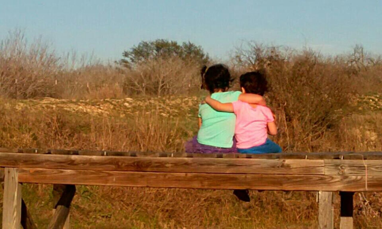 two people, togetherness, love, rear view, child, bonding, childhood, girls, people, friendship, outdoors, children only, females, day, sitting, full length, adult, cheerful, sky, nature, young adult