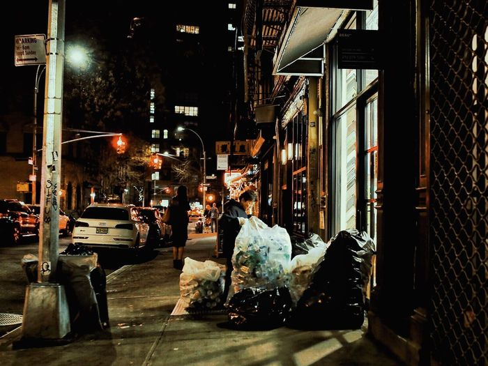 Building Exterior Built Structure Night Architecture City Incidental People Illuminated Glass - Material Street Outdoors Retail  Shopping Transparent Window Men Business One Person Store Transportation