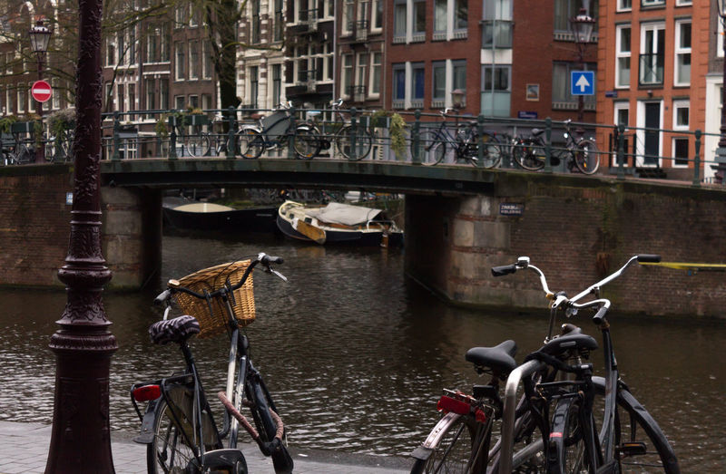 Bicycles on canal in city