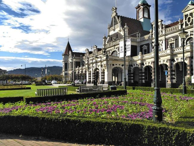 Dunedin Railway Station Architecture Travel Destinations Cloud - Sky History No People Outdoors Statue Sky Plant Nature Built Structure Building Exterior Day Flowerbed Flower Grass